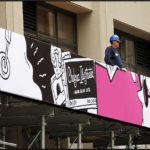 Large banner/ graphic girl with headphones in pink/ white/ black