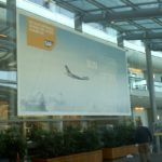 Large banner showing airplane and words