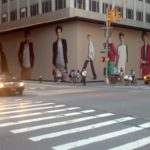 large format digital printing graphics on city street corner outside store taking up several city blocks