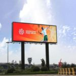 Large billboard/ digital message sign with tennis player