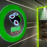 "Round Green Neon Sign and sushi graphic for Japanese restaurant ""Wasabi"""