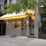 lighted yellow awning outside store
