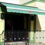 green awning outside store/ restaurant