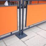 close-up of orange sidewalk barrier