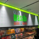 "Sign for japanese restaurant in mall ""Wasabi sushi & bento"""