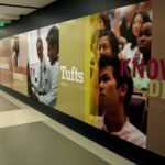 Large wall graphic for Tufts University with students and words