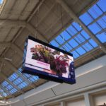 Large hanging digital sign inside commerical space