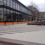long orange sidewalk barrier/ barricade outside restaurant building