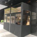 Winter vestibule, double doorway matches building in black