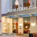 Double Tree by Hilton entrance showing Channel letters and structural and glass canopy above doorway